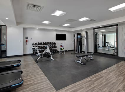 fitness center with various weights and machines