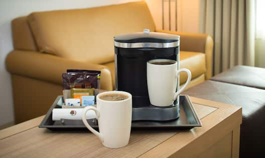 Tray on Hospitality Center With Standard Coffee, Mugs, and Sweeteners