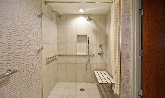 Roll-in shower with shower seat