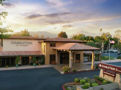a hotel exterior and drive up entrance