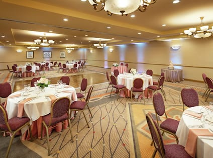 a ballroom room with banquet tables and a dance floor