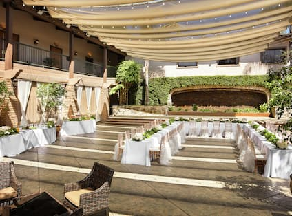 an outdoor wedding table and reception set up