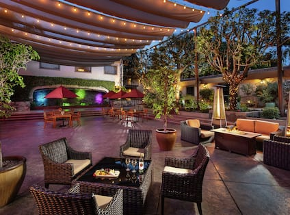 an outdoor patio with seating and a fire pit