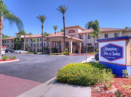 Exterior shot of  hotel with Hampton Inn & Suites sign