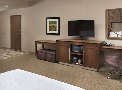 Guest Bedroom with Queen Bed, Television and Work Desk