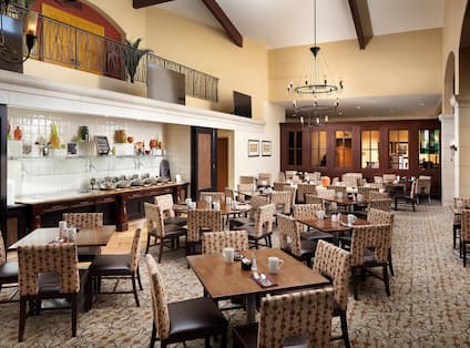 Food Service Area, Tables, and Chairs in Restaurant Dining Room