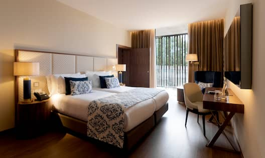 Large Bed and Desk in Hotel Guest Room