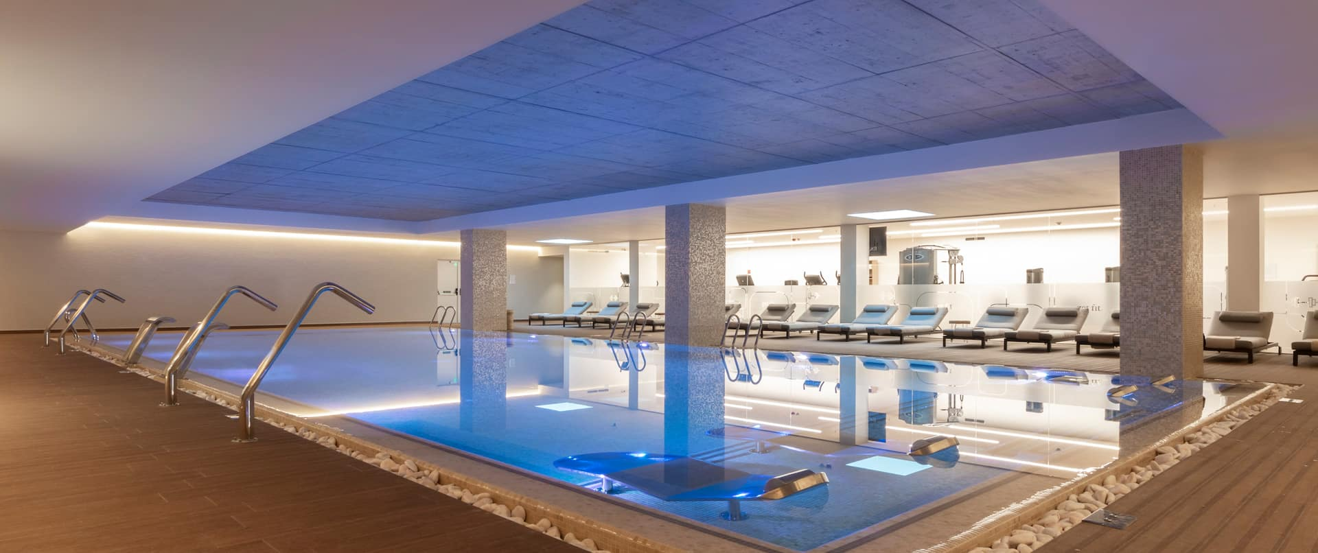 Indoor Pool with Seating Area at the Spa