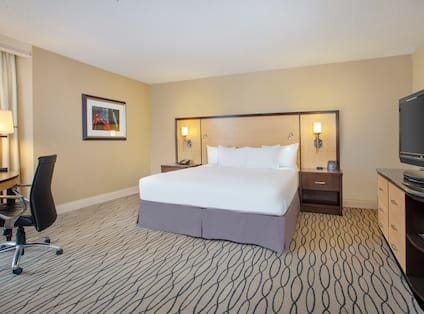 Large Bed in Guest Room with Desk and HDTV