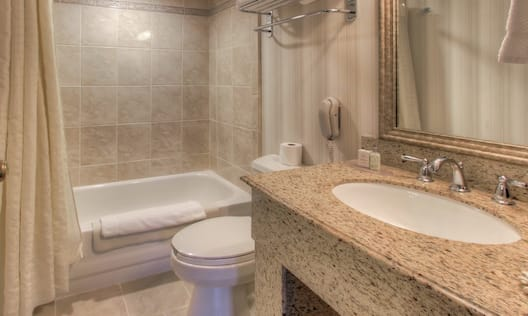 Bathroom with bath and sink