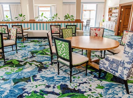 Swan Terrace Grill blue floral carpeting