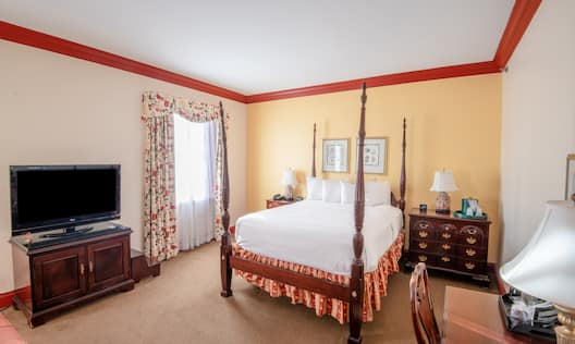 Bedroom with bed and TV