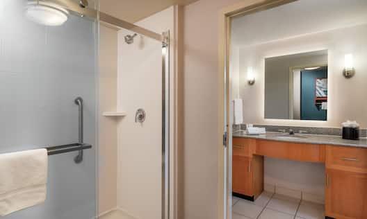 Shower and Vanity in Suite Bathroom