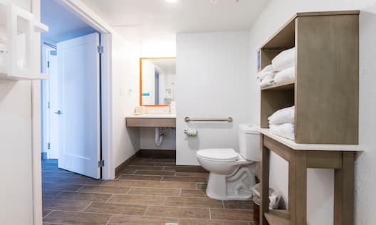 Accessible Bathroom with Grab Bars and Towels