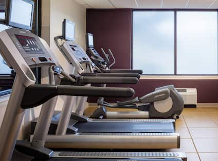 Fitness Center With Cardio Equipment and Frosted Windows