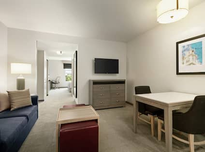 Urban Suite Living and Dining Area with HDTV, Sofa and Table for 2