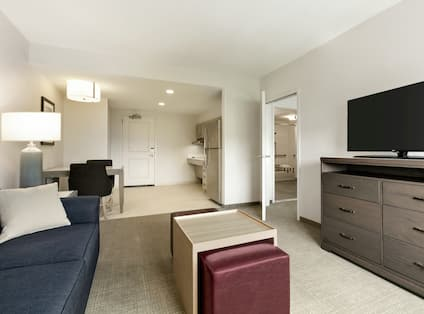 Accessible One Bedroom King Living Area with HDTV and Kitchen