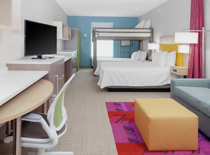 Studio Suite with Bunk and Queen Beds, TV, Work Desk, and Lounge Area