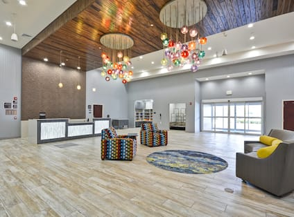 Homewood Suites by Hilton Orlando Theme Parks - Front Desk with Seating Area