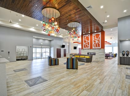 Homewood Suites by Hilton Orlando Theme Parks - Front Desk with Seating and Fireplace