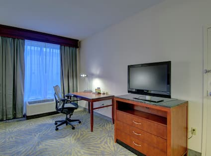 Room with Work Desk and TV