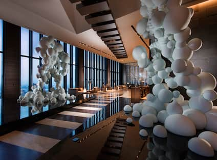 Lobby at Conrad Osaka with featuring artwork and sculptures.