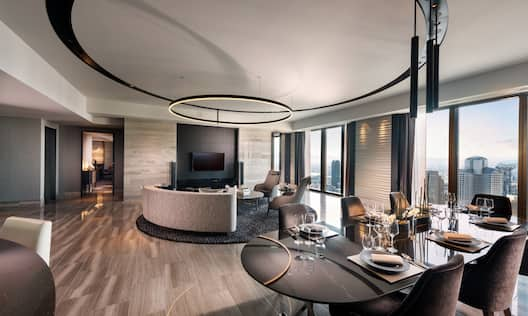 Large room with dining area and view