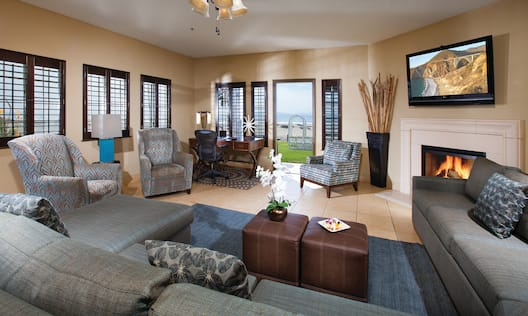Suite Living Room with Couch, Chairs, Fireplace, TV, Work Desk and Outside View