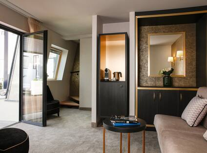 Junior Suite Living Area with Lounge Seating, Staircase to Bedroom, Outside View and Patio