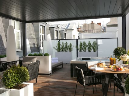 Outdoor Terrace with Lounge Seating, Dining Table and Jacuzzi Tub