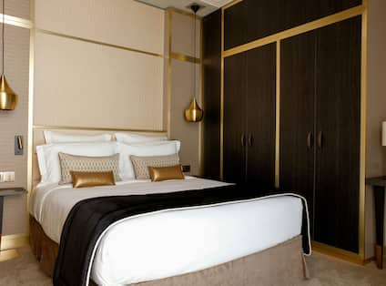 Suite Bedroom with Queen Bed and Closet