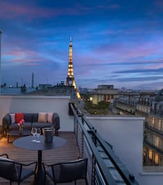 Suite Balcony in the Evening with City and Eiffel Tower View