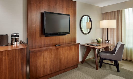 King Guest Room with Work Desk and Wall-Mounted TV