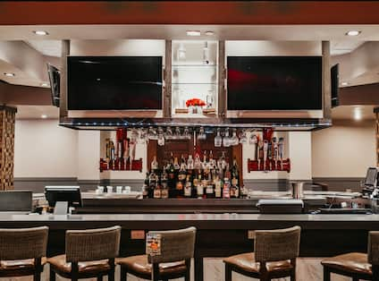 Bar area with stools and TV