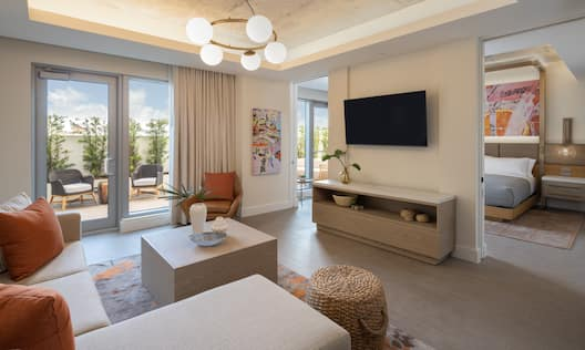 Overview of Suite Living Room with HDTV and Outdoor Patio Area