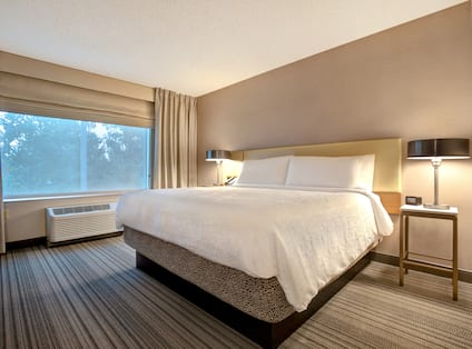 guest room with bed and window