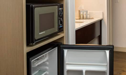 King Room Hospitality Center With Microwave and Mini Fridge With Open Door