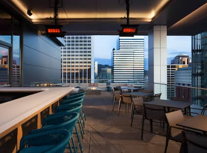 Balcony area with tables and chairs, with city view