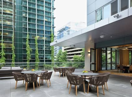 Outdoor Patio Seating Area with Tables and Chairs