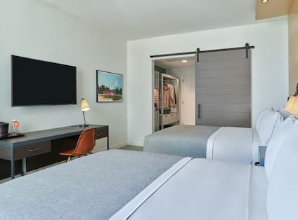 Two Queen-Sized Beds, Work Desk with Chair, Flat Screen TV, and Closet in Guest Room