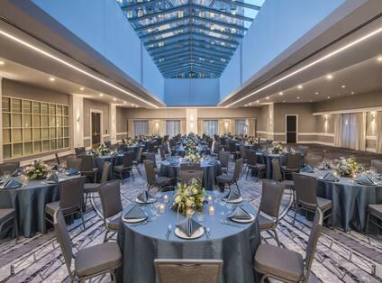Atrium Reception Room with Banquet Round Tables Setup