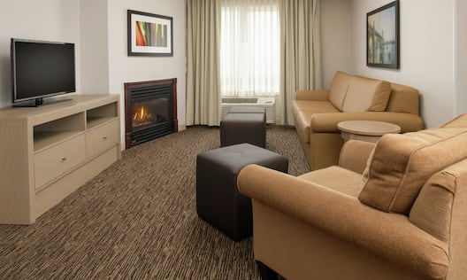 Living Room in our 1 King Bed Junior Suite with Fireplace