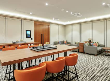 DoubleTree Hotel Breakout Room with Tables, Chairs, and Booths