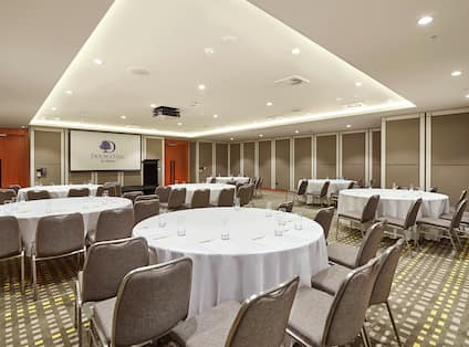 Jarrah Meeting Room with Tables and Chairs Cabaret Style with Projector Screen