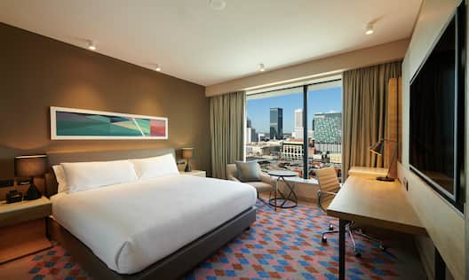 King Executive Guestroom with Bed, Work Desk, Lounge Area, Room Technology, and Outside View