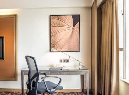 Workdesk with Chair and Art on Wall