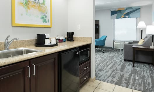 Guest Room with Wet Bar Area and Work Desk