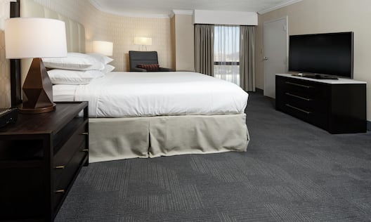 King Guest Room with HDTV and Soft Chair
