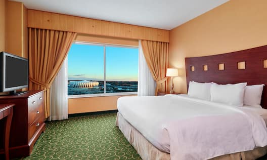 King Bed in Guest Room with Window View