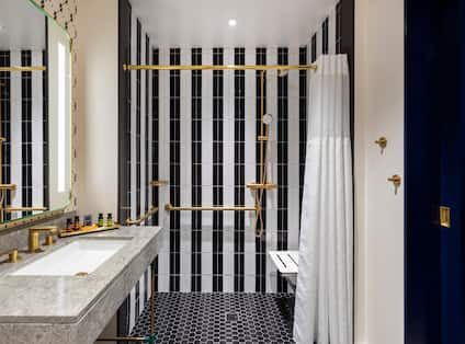 Bathroom with shower and seat